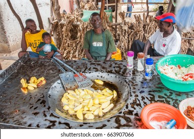 LILONGWE, MALAWI - SEPTEMBER 05 2009: A typical Malawian street food stand selling potato chips.