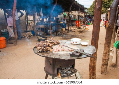 LILONGWE, MALAWI - SEPTEMBER 05 2009: A typical local street market scene, showing a traditional Malawian dish, Nthumbwana, made from animal organs (usually goat) and wrapped in it's intestines.