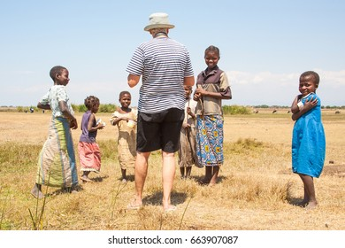 LILONGWE, MALAWI - SEPTEMBER 05 2009: Poor African Malawian children gather to talk to tourist of European decent. They call these tourists Mzungu's (white people).