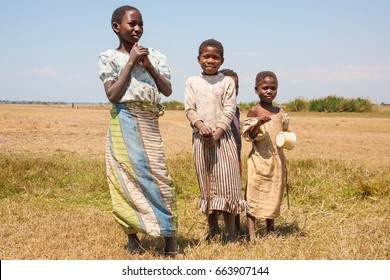 LILONGWE, MALAWI - SEPTEMBER 05 2009: Poor Malawian children gather to play in the grasslands near Lilongwe, wearing old and dirty clothing.