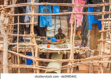 LILONGWE, MALAWI - SEPTEMBER 05 2009: An African Malawian man selling his wears in a makeshift shop at a street market near Lilongwe.