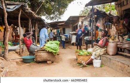 LILONGWE, MALAWI - SEPTEMBER 05 2009: A typical scene at a Malawian fresh food market. Greens are sold from hand made baskets.