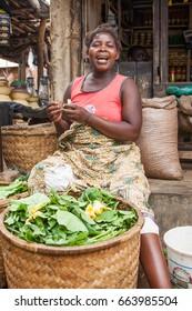 LILONGWE, MALAWI - SEPTEMBER 05 2009: An African Malawian woman selling fresh pumpkin leaves at a fresh food market near Lilongwe.