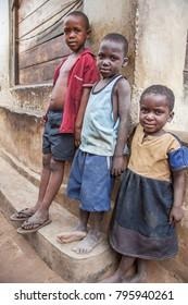 LILONGWE, MALAWI - SEPTEMBER 05 2009: African children hanging around a rural food market near Lilongwe.