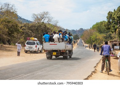LILONGWE, MALAWI - SEPTEMBER 05 2009: An overloaded truck on a rural road in Malawi.