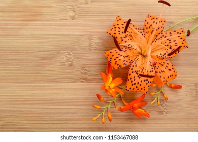 lily arrangement on the wooden board