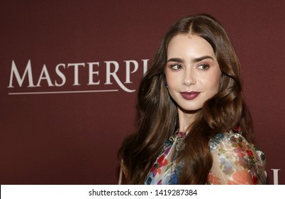 Lily Collins at the 'Les Miserables' Photo Call held at the Linwood Dunn Theater in Los Angeles, USA on June 8, 2019.