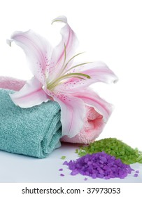 Lily flower, towels, and aromatic salts