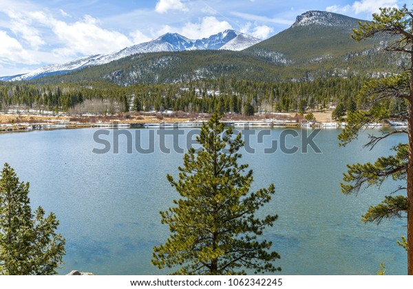 Lily Lake - A Spring view of Lily Lake, with Mt. Meeker (left, 13,911 ft) and Longs Peak (right, 14,255 ft) rising high in background, in Rocky Mountain National Park, Estes Park, Colorado, USA.