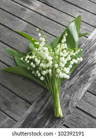 lily of the valley  on old wooden table