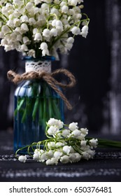 Lily of the valley on a wooden background with copyspace. Lily of the valley bouquet. Space for text