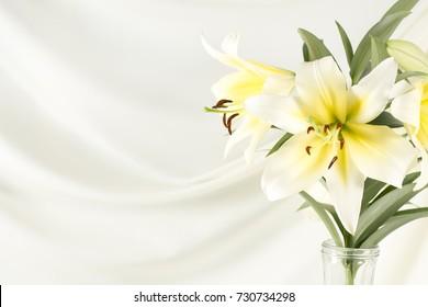 lily white yellow on white fabric.