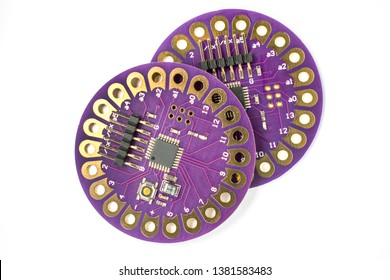 Lilypad DIY board isolated on white background close up top view. The brain for robots. Board for engineering prototyping in fablab