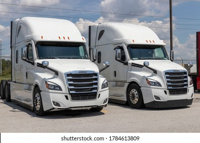 Lima - Circa July 2020: Freightliner Semi Tractor Trailer Trucks Lined up for Sale. Freightliner is owned by Daimler Trucks.
