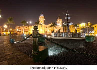 Lima main square cathedral church and antique pool.
