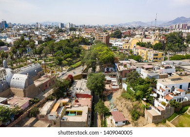 """Lima, Perú - March 27 2019: Aerial view of Barranco district and Whisper bridge. """"Puente de los Suspiros"""" is a touristic place for visit surrounded by colonial buildings and restaurants in Lima, Peru."""