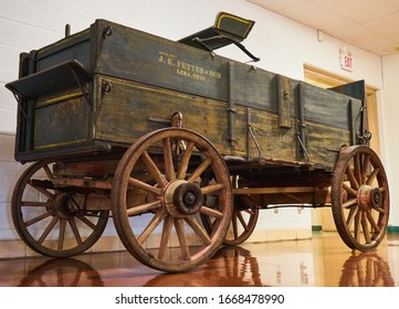 Lima, Ohio / USA - March 7 2020: A J.K. Fetter & Son Studebaker wooden  horse drawn wagon display at the Allen County Museum.