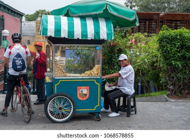 Lima, Peru -- April 13, 2018. A vendor with a fiid truck displays chips and popcorn for sale in the Brranco District. Editorial use only.