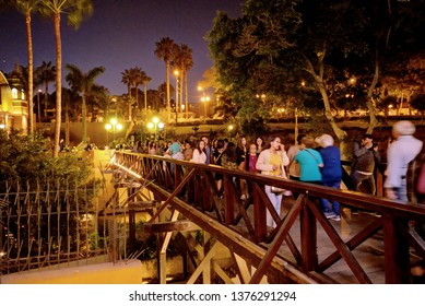 Lima, Peru - April 21, 2018: Barranco in Lima Peru at night with tourists crossing a bridge on foot