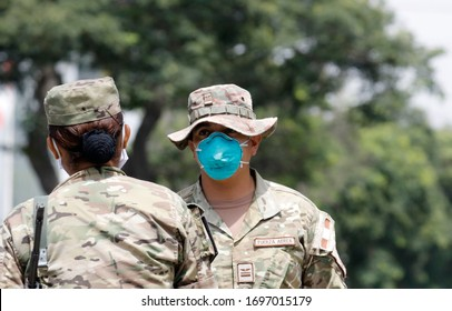 Lima, Peru; April 7, 2020: Peruvian army soldiers wearing a face mask N95 patrol a street during COVID-19 health crisis and   quarantine