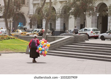 """LIMA, PERU - AUG 29th 2015: Old woman selling balls to survive poverty"""