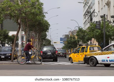 LIMA, PERU - AUG 29TH 2015: The chaos of traffic in the city of Lima, affecting cyclists, pedestrians and vehicles. Lima Peru