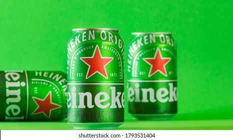 Lima, Peru - August 10 2020: Heineken beer can green background. .Heineken beer is the flagship product of Heineken International.