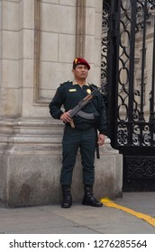 LIMA / PERU, August 18, 2018: A soldier guards the government palace in the Plaza de Armas of Lima
