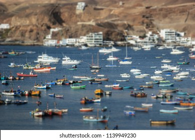 Lima, Peru: Boats in traditional fisher harbor of Pucusana.
