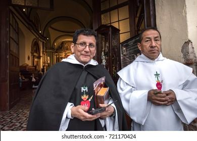 LIMA, PERU - CIRCA 2017: Two priests at the door of a church circa 2017 in Lima, Peru.