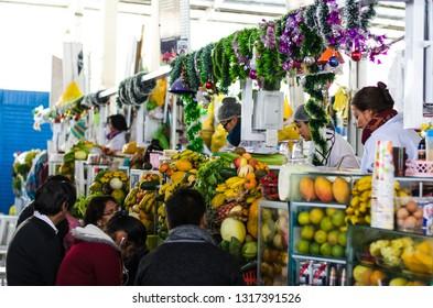 Lima, Peru December 30th, 2018 : Juice vendors inside the San Pedro market in Cusco - Peru