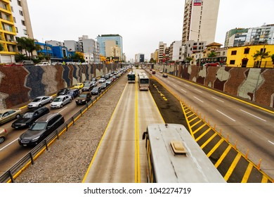 Lima, Peru - February 2, 2018: Traffic jam on one of the highway roads Paseo de la República in the Miraflores neighborhood, Lima, Peru. Meanwhile, buses travel in the Metrobus lane