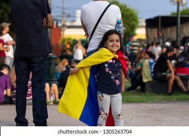 Lima, Lima / Peru - February 2 2019: Adorable cute little girl playing with Venezuelan flag at protest against Nicolas Maduro