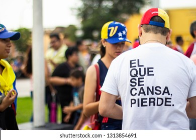 "Lima, Lima / Peru - February 2 2019: Venezuelan man wearing t shirt with ""el que se cansa pierde"" sign standing at protest against Nicolas Maduro"