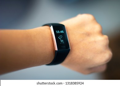 Lima, Peru - February 20 2019: Woman monitoring her heart beat with a fitbit charge 3 activity tracker wearable device on her wrist also known as fitness tracker