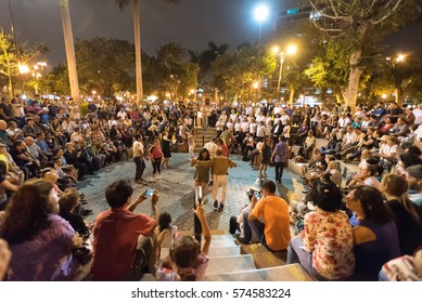 LIMA, PERU - JAN 20: Live music and crowds in Parque Kenney in Miraflores, Lima, Peru on January 20, 2018. The park is popular for tourists and locals and is named after US President John F. Kennedy.
