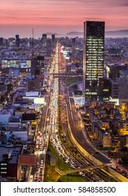 LIMA, PERU: Javier Prado avenue at rush hour in blue time.