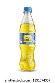 LIMA, PERU - July 10, 2018: Classic bottle Of Inca Kola isolated on white.