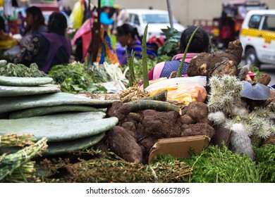 Lima, Peru – July 19, 2014 –  herbs, roots, spices, greenery being sold on street  at traditional market