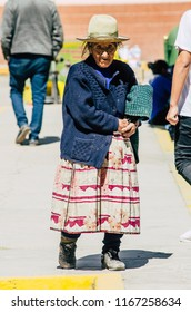 Lima, Peru - JULY 27th 2018 : Peruvian traditional old woman in Canta - Lima. Elderly woman walking through the streets of Canta