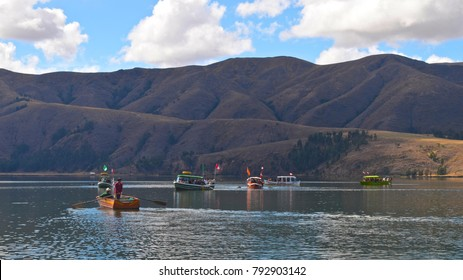Lima, Peru - July 28th, 2014:  Boats full of tourists sail on the Laguna de Paca, near Huancayo, Peru