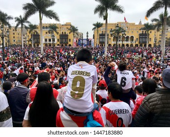 LIMA, PERU - JULY 7, 2019: Peruvian football fans supporting their national team at the Plaza de Armas in Lima, Peru.