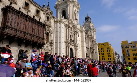 Lima, Peru - July 8th, 2019: Copa america. Cheering People watching the Football match between Peru and Brazil at the Plaza de armas in Lima.