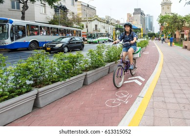 LIMA, PERU - MAR 27: A biker on marked bike path in the Miraflores section of Lima, Peru on March 27, 2017. Miraflores is a gentrified neighborhood in Lima and is popular for locals and tourists.