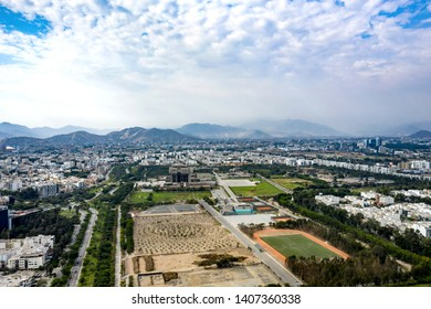 Lima, Peru - March 20 2019: Aerial view of Pentagonito area in San Borja district. Military base in Lima, Peru. Green spaces and hills in the background.
