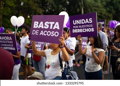 Lima, Peru - March 8 2019: Group of girls and women with banners of stop harresement at woman's day march. Gender equality, abortion rights and feminism concept.