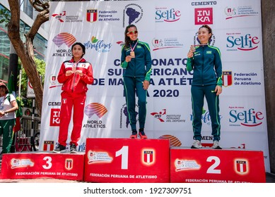 LIMA, PERU - MARCH 8, 2020: Viviane Lyra, Mayara Vicentainer, and Yoci Caballero pose with their first, second, and third place medals respectively in the 50km race walk category  in the South America