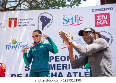 LIMA, PERU - MARCH 8, 2020: Brazilian sprinter Robson da Silva celebrates Viviane Lyra after receiving her first place medal in the South American Race Walking Championship.