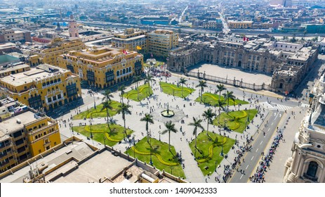 """Lima, Peru - May 19 2019: Aerial view of Lima main square, government palace of Peru and cathedral church. Tourists and people gathered at """"Plaza de Armas"""" in the historic center capital of Peru."""