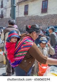 Lima, Peru - May 23, 2016: Woman with the baby  on the street of Cusco. Kechua, peruano woman.